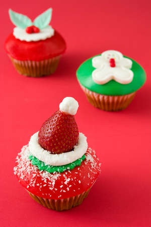 christmas cupcakes: Christmas cupcakes on red background Stock Photo