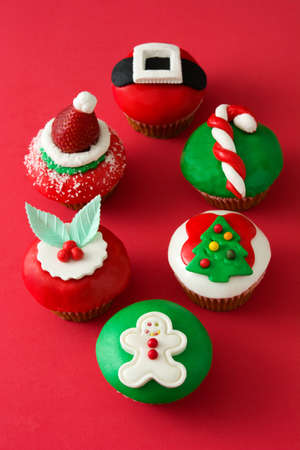 Christmas cupcakes on red background Stock Photo