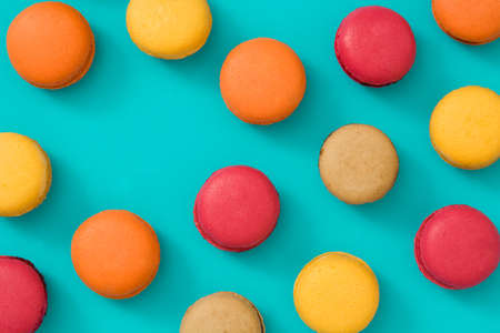 Colored macaroons on blue background Foto de archivo