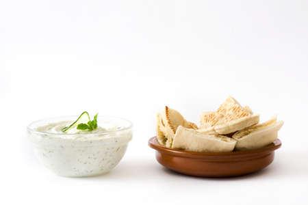 pita bread: Tzatziki sauce and pita bread isolated on white background Stock Photo