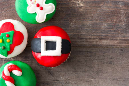 christmas cupcakes: Christmas cupcakes on rustic wooden background Stock Photo