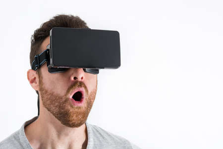 new idea: Man wearing virtual reality goggles