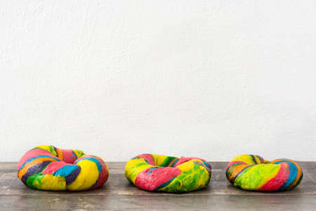 bagels: Colorful bagels on a wooden table
