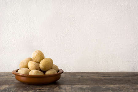 canarian: Canarian potatoes (boiled potatoes) on wooden table Stock Photo