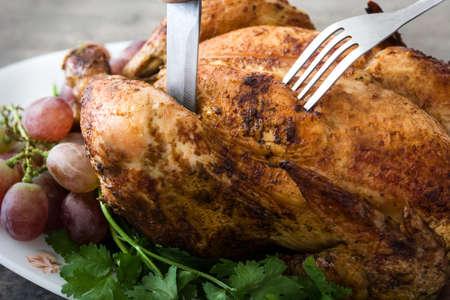 Carving the Thanksgiving turkey Archivio Fotografico