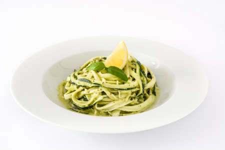 Zucchini noodles with pesto sauce isolated on white background