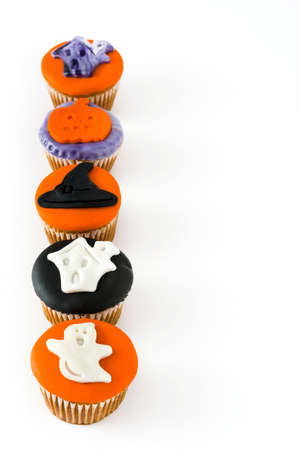 Halloween cupcakes isolated on white background
