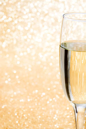 and brilliant: Champagne glass cup on brilliant golden background