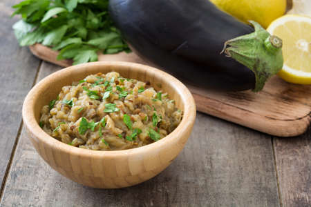 Eggplant and baba ganoush on wooden table