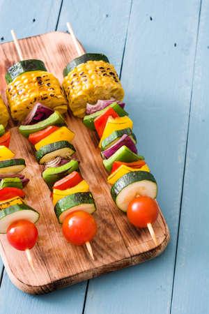 Vegetable skewers on blue wooden table