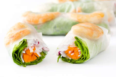 Vietnamese rolls with vegetables, rice noodles and prawns isolated on white background Banco de Imagens
