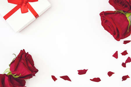 red gift box: Gift box and red rose on white background