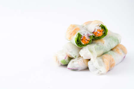 Vietnamese rolls with vegetables, rice noodles and prawns isolated on white background Stock Photo