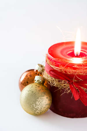 Red Christmas candle and Christmas ornaments on white background Stock Photo