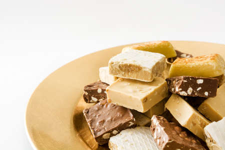 nougat: Christmas nougat on a golden plate isolated on white background Stock Photo