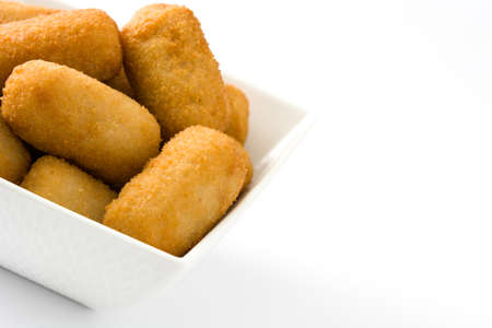 Traditional Spanish fried croquettes isolated on white background Foto de archivo