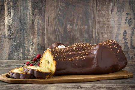 yule log: Chocolate yule log cake on wooden christmas background