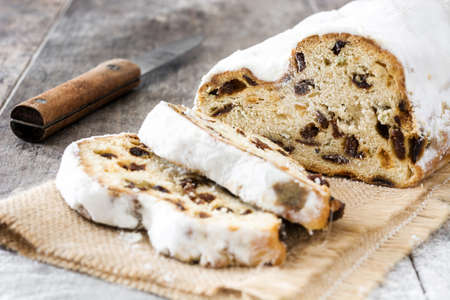 Christmas stollen. Traditional German Christmas dessert on wooden background