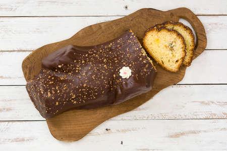 yule log: Chocolate yule log cake on white wooden christmas background Stock Photo