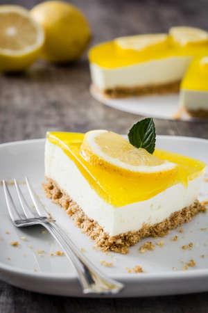 pie de limon: Lemon pie on wooden background Foto de archivo