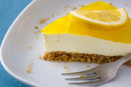 pie de limon: Lemon pie on blue wooden background Foto de archivo