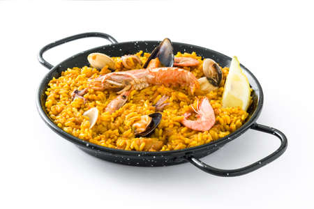 Traditional Spanish seafood paella, isolated on white background