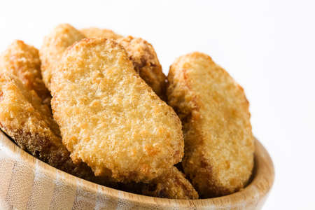 Fried chicken nuggets in bowl isolated on white background