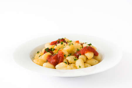 Gnocchi with tomato sauce isolated on white background.