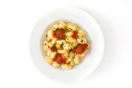 Gnocchi with tomato sauce isolated on white background.Top view