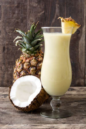 Pi� � a colada cocktail on wooden background.