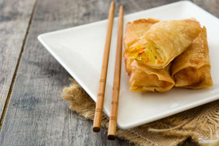 Vegetable spring rolls on wooden table background