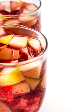 white wine: Sangria drink in glass isolated on white background. Stock Photo