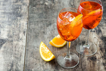 Aperol spritz cocktail in glass on wooden table Stock Photo