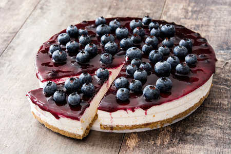 Blueberry cheesecake on wooden table 写真素材