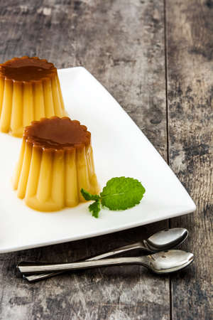 Caramel cream. Egg pudding on wooden table Stock Photo