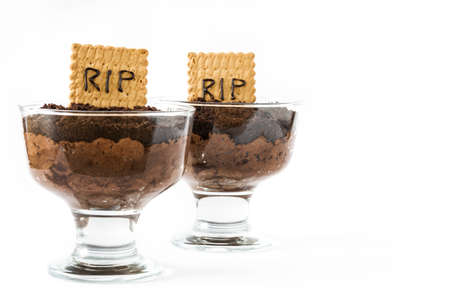 truck: Funny Halloween chocolate mousse with tomb cookie isolated on white background Stock Photo