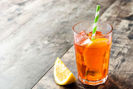 spritz: Aperol spritz cocktail in glass on wooden table Stock Photo