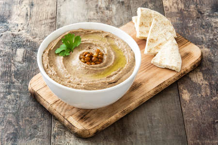 Lentil hummus in bowl with pita bread on wood Stock fotó
