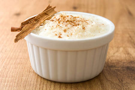 Rice pudding. Rice pudding with cinnamon on wooden background