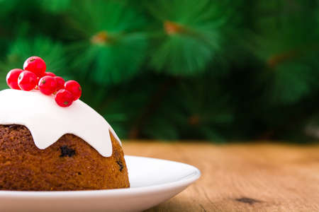 Christmas pudding on wooden table