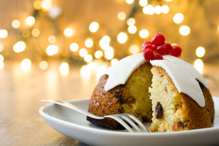 Christmas pudding and christmas light on wooden table Stock Photo