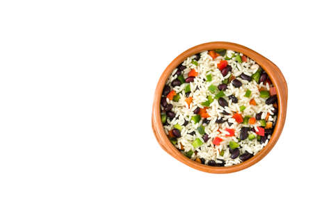 Traditional cuban rice, black beans and peppers top view isolated on white background. Moors and Christians.