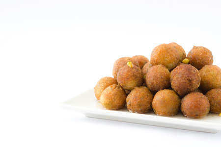 Gulab jamun isolated on white background. Traditional indian dessert.