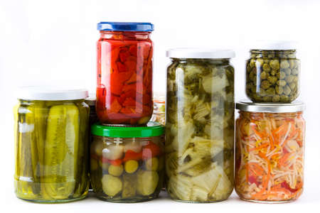 Fermented preserved vegetables in jar isolated on white background Stock Photo