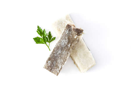 Salted dried cod isolated on white background. Typical Easter food