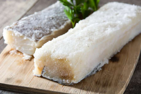 Salted dried cod on wooden table. Typical Easter food Stock Photo