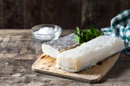 Salted dried cod on wooden table. Typical Easter food Archivio Fotografico