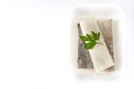 Salted dried cod isolated on white background. Top view copyspace.Typical Easter food Stock Photo