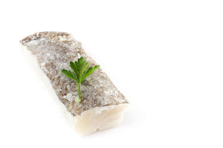 Salted dried cod isolated on white background. Typical Easter food. Copyspace