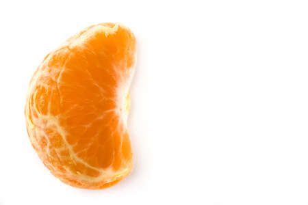 Fresh piece of tangerine isolated on white background. Top view